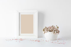 Empty picture frame, decorated with small pink flowers Royalty Free Stock Images
