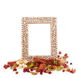 Empty picture frame with dried flowers and leaves Stock Photo