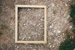 Empty picture or frame. Empty picture or photo frame on stone rough texture royalty free stock image