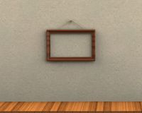 Empty picture frame hanging on a rope brick wall wooden floor Stock Photo