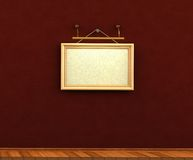 Empty picture frame hanging on a rope brick wall wooden floor Stock Photos