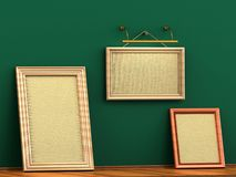 Empty picture frame hanging on a rope brick wall wooden floor Royalty Free Stock Images