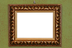 Empty picture frame ( with inside clipping path ). On a green wall Royalty Free Stock Images