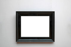 Empty picture frame. Empty ornate picture frame with white copy space hanging on museum wall design template stock photo