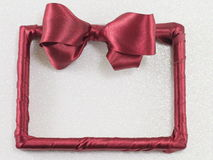 Empty picture frame with red ribbon Stock Photography