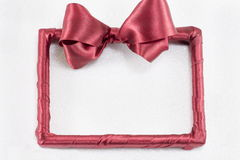 Empty picture frame with red ribbon Royalty Free Stock Photos