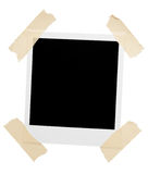 Empty picture frame taped corners stock photo