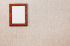 Empty picture frame on the wall. Brown empty picture frame hanging on the wall Royalty Free Stock Photos