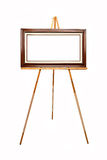 Empty picture frame on wooden easel. Empty picture frame waiting for your art work on wooden easel Royalty Free Stock Photography