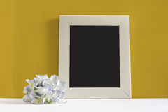 Empty picture frame on yellow background Royalty Free Stock Photos