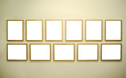 Empty picture frames on gallery wall Stock Images