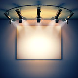 Empty picture illuminated by spotlights. Stock Image