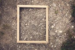 Empty picture or photo frame. Empty picture or photo frame on stone rough texture Stock Image
