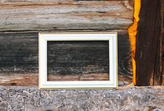 Empty picture or photo frame. Empty picture or photo frame on weathered wood background Stock Photo