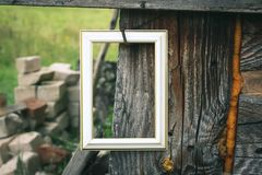 Empty picture or photo frame. Empty picture or photo frame on weathered wood background stock images