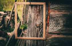 Empty picture or photo frame. Empty picture or photo frame on weathered wood background royalty free stock photos