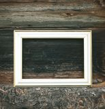 Empty picture or photo frame. Empty picture or photo frame on weathered wood background Royalty Free Stock Image