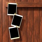 Empty pictures. Three empty pictures on wood background. Additional PNG format available where the black rectangle on the picture frame is a mask and a Stock Photo