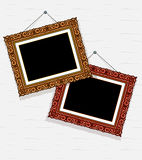 Empty pictures in decorative frame on the wall Royalty Free Stock Photos