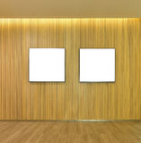 Empty pictures frame in wood slats wall inside of home, mock up royalty free illustration