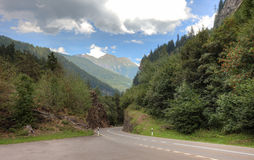 Empty picturesque road. In swiss Alps, Europe Stock Image