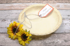 Empty pie shell dish with Happy Thanksgiving Royalty Free Stock Image