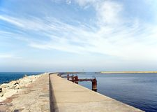 Empty pier. A port entrance, empty, two piers, beacons Stock Photo