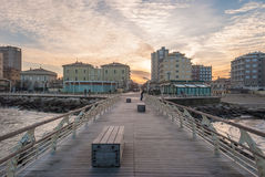 Empty pier with benches on the sea in Pesaro during the sunset Royalty Free Stock Photography