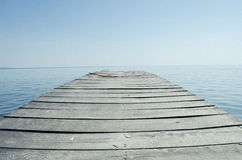 Empty pier and big lake. Stock Images