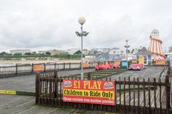 Empty Pier with kids ride and helter skelter in background. Clacton  Essex United Kingdom  -29  September  2017: Empty Pier with kids ride and helter skelter in Stock Images