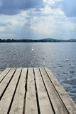 Empty pier in lake. Empty pier in calm lake royalty free stock image