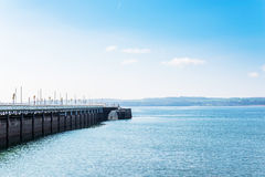 Empty pier over the ocean bay, beautiful blue ocean pane, blue s Royalty Free Stock Photography