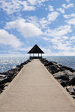 Empty pier in a peaceful sea harbor on a background of blue sky Stock Photography