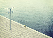 Empty pier by the river. Royalty Free Stock Images
