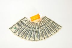 Empty pill bottle with money Stock Photos