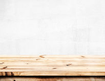 Empty pine wood table with white wall background. Royalty Free Stock Photos