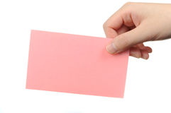 Empty pink business card in a woman's hand Stock Photography