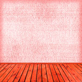 Empty pink interior: concrete wall, wooden floor Royalty Free Stock Photos