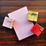 Empty pink paper gift card with gift box Stock Image