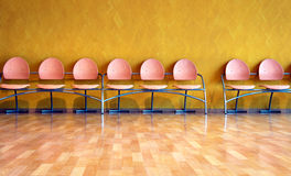 Empty pink plastic chairs Royalty Free Stock Images
