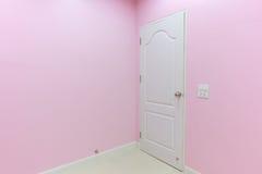Empty pink room with door Royalty Free Stock Photos