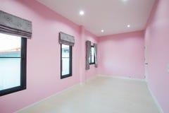 Empty pink room with door and window Stock Photography