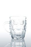 Empty pitcher. Reflected on a white background Stock Photos