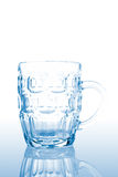 Empty pitcher. Reflected on a white background Stock Image