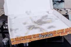 Empty pizza box. With grease stains, a  fast food concept Royalty Free Stock Photography