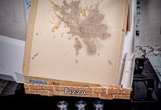 Empty pizza box. With grease stains, a  fast food concept Royalty Free Stock Photo
