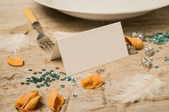 Empty Place Card Surrounded by Sequins, Petals, Feathers, Fork Stock Images