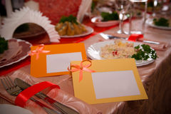 Empty place card on the white festive table Stock Photography