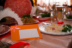 Empty place card on the white festive table Royalty Free Stock Photos