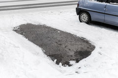 Empty place in parking lot, snowy roadside in Finland Royalty Free Stock Images